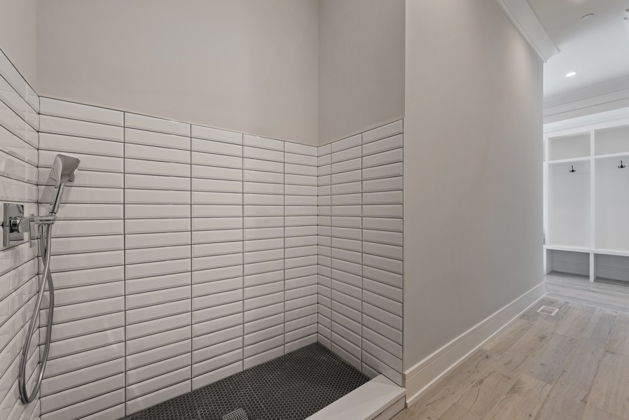 Real Estate Photography - 901 Bluff Rd, Glencoe, IL, 60022 - Mudroom with Doggy Shower