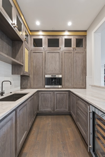 Real Estate Photography - 901 Bluff Rd, Glencoe, IL, 60022 - Wet bar, cappucino maker and additional cabinetry