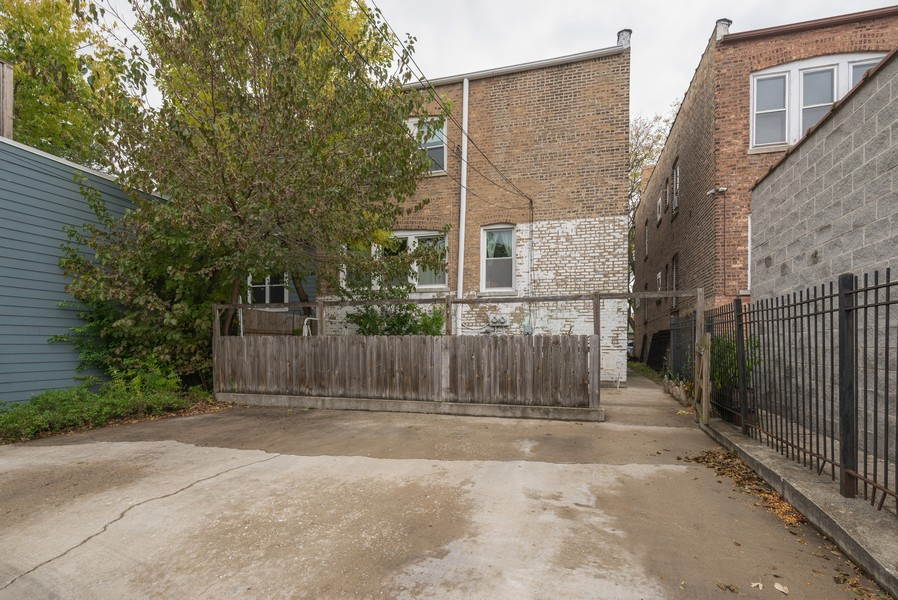 Real Estate Photography - 2651 W Winona Street, Chicago, IL, 60625 - Rear view with 3-car parking pad