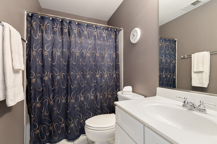 Real Estate Photography - 1300 Mulberry, Cary, IL, 60013 - En suite bath for 3rd bedroom