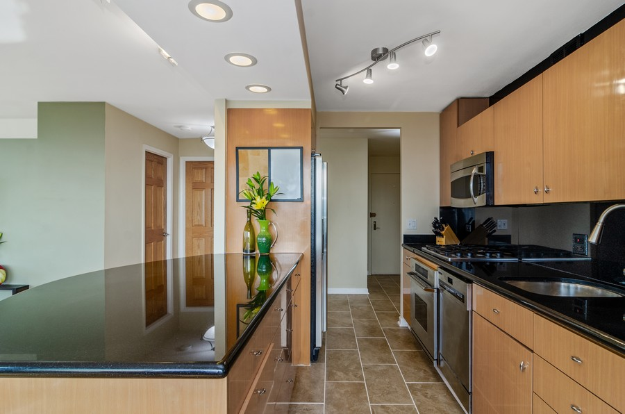Real Estate Photography - 2800 N. Lake Shore Drive, Unit 1716, Chicago, IL, 60657 - Kitchen with eat-in counter