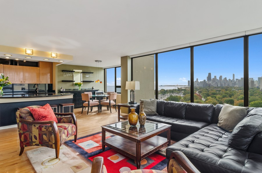 Real Estate Photography - 2800 N. Lake Shore Drive, Unit 1716, Chicago, IL, 60657 - Living Room/Kitchen with Skyline Views