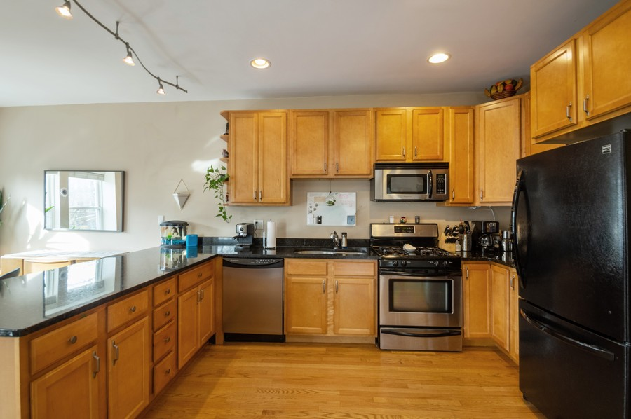 Real Estate Photography - 3100 W Leland, #201, Chicago, IL, 60625 - Kitchen
