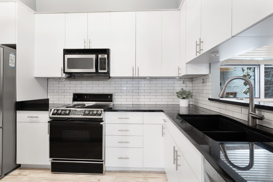 Real Estate Photography - 1842 N Halsted Street, Unit 1, Chicago, IL, 60614 - Kitchen