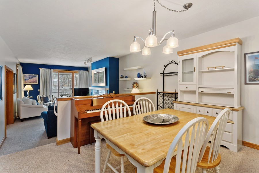 Real Estate Photography - 501 N Whittaker St, Unit 22, New Buffalo, MI, 49117 - Dining Room