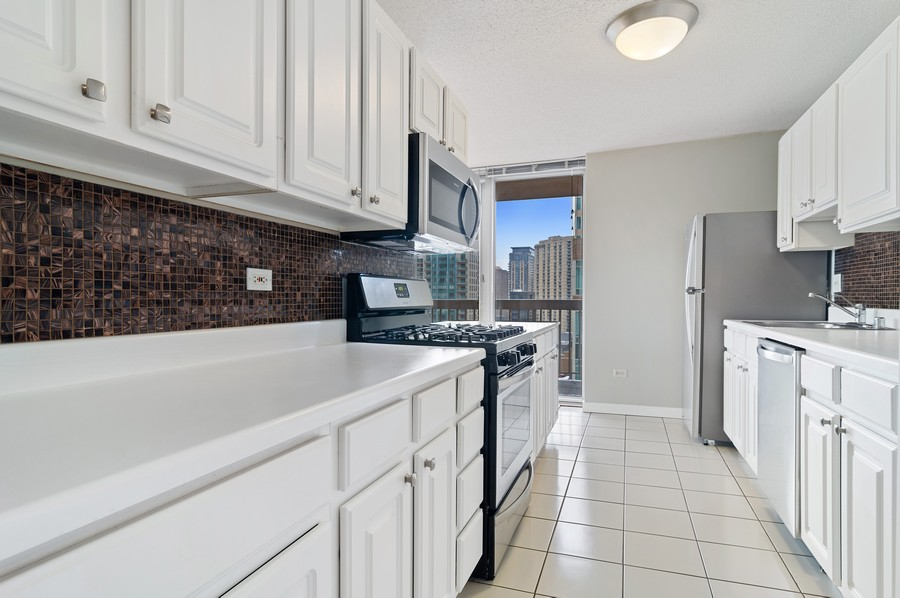 Real Estate Photography - 545 N Dearborn St, Apt 1501, Chicago, IL, 60654 - Kitchen