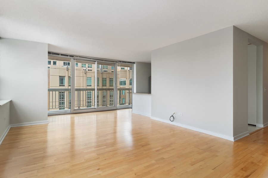 Real Estate Photography - 545 N Dearborn St, Apt 1501, Chicago, IL, 60654 - Kitchen / Living Room