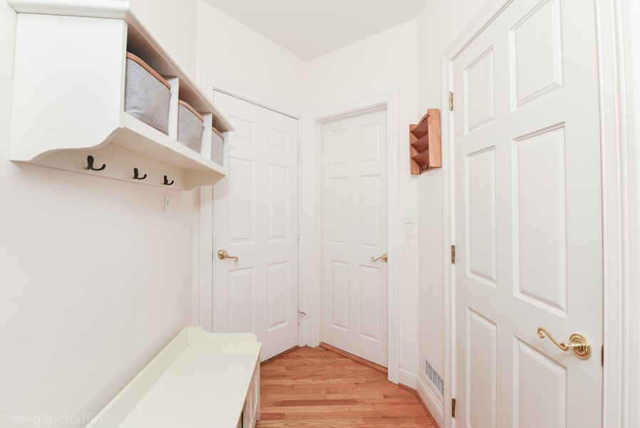 Real Estate Photography - 2126 Thornwood, Wilmette, IL, 60091 - Mudroom with built-in bench and cubbies