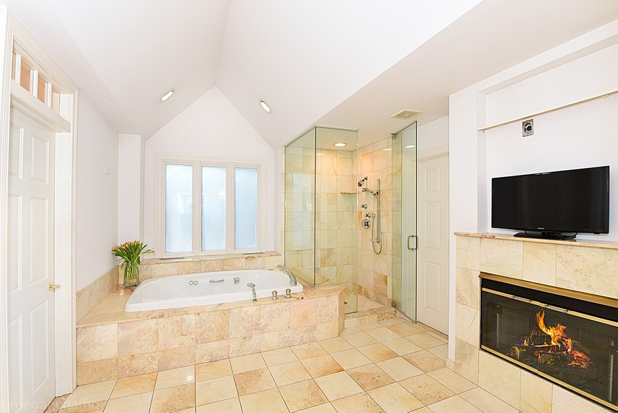Real Estate Photography - 2126 Thornwood, Wilmette, IL, 60091 - First floor guest suite spa bathroom