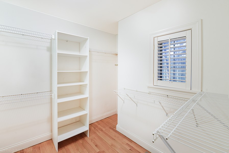 Real Estate Photography - 2126 Thornwood, Wilmette, IL, 60091 - Large guest suite closet with built-in shelves