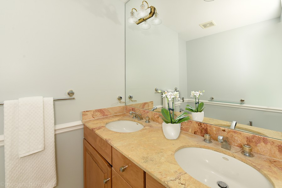Real Estate Photography - 2126 Thornwood, Wilmette, IL, 60091 - First floor guest suite bathroom has double vanity