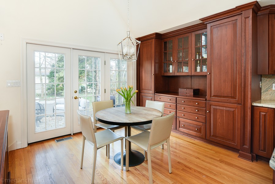 Real Estate Photography - 2126 Thornwood, Wilmette, IL, 60091 - Sun-lit breakfast room has French doors to patio