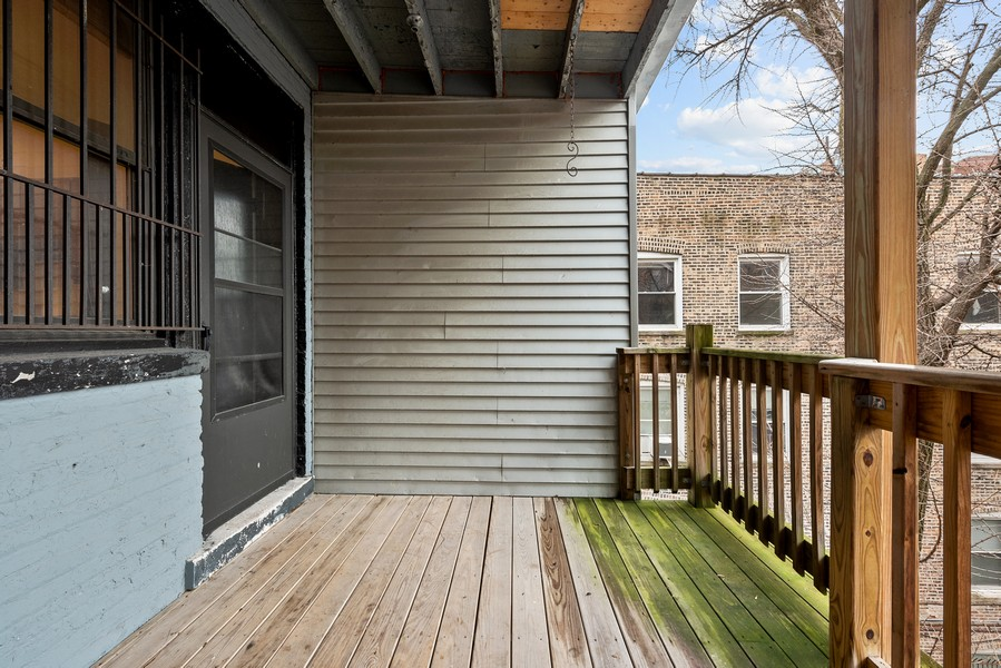 Real Estate Photography - 3723 N Pine Grove #3N, Chicago, IL, 60613 - Back Deck off Kitchen