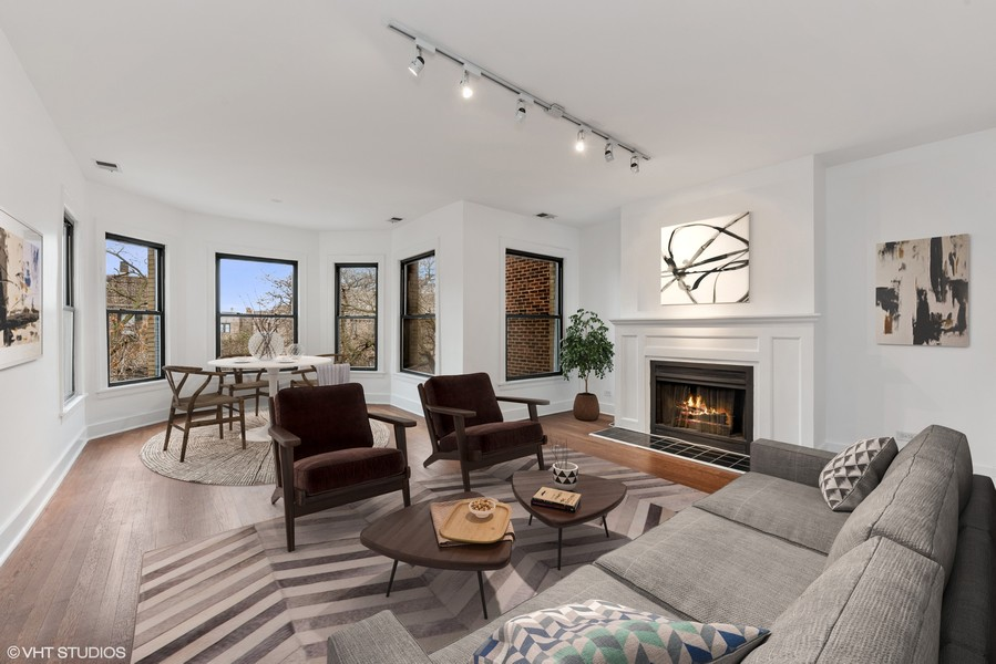 Real Estate Photography - 3723 N Pine Grove #3N, Chicago, IL, 60613 - Front Living and Dining Room with Fireplace