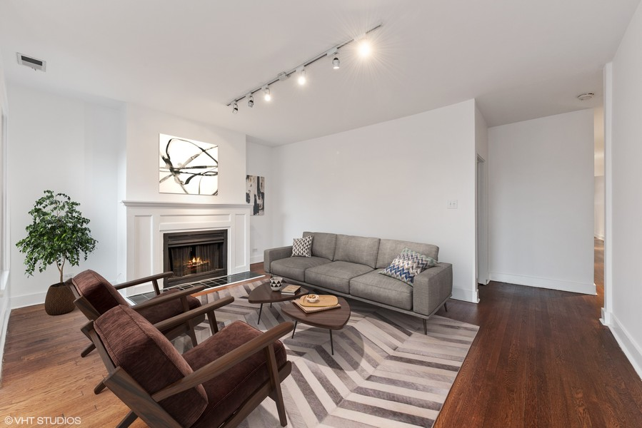 Real Estate Photography - 3723 N Pine Grove #3N, Chicago, IL, 60613 - Front Living Room with Wood-burning Fireplace