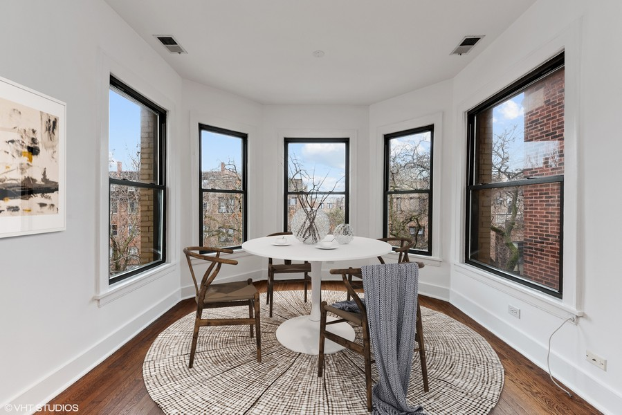 Real Estate Photography - 3723 N Pine Grove #3N, Chicago, IL, 60613 - Front Dining Room with Bay Windows