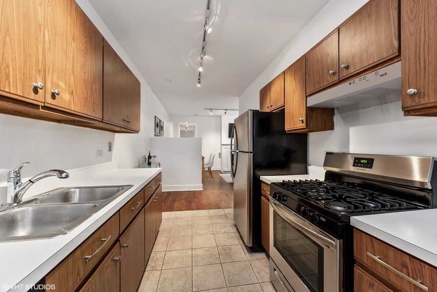 Real Estate Photography - 3723 N Pine Grove #3N, Chicago, IL, 60613 - Kitchen has New Stainless Steel Appliances