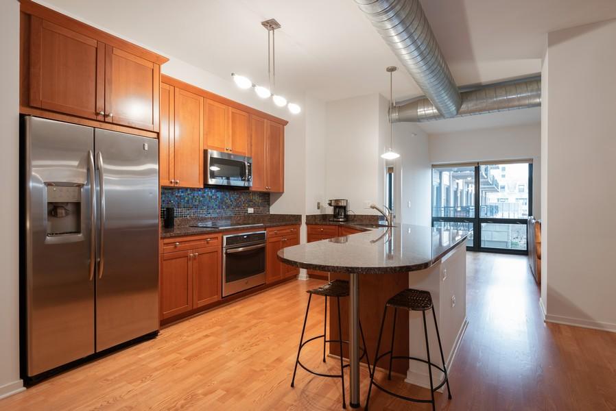 Real Estate Photography - 807 Davis Street, Unit 409, Evanston, IL, 60201 - Kitchen