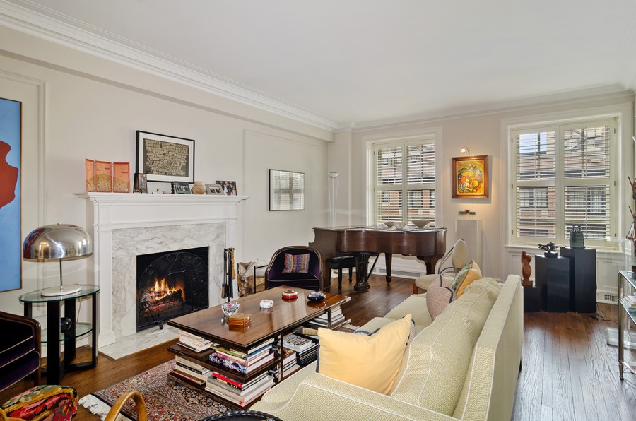 Real Estate Photography - 237 E Delaware Pl, Unit 7B, Chicago, IL, 60611 - Living Room with Wood Burning Fireplace