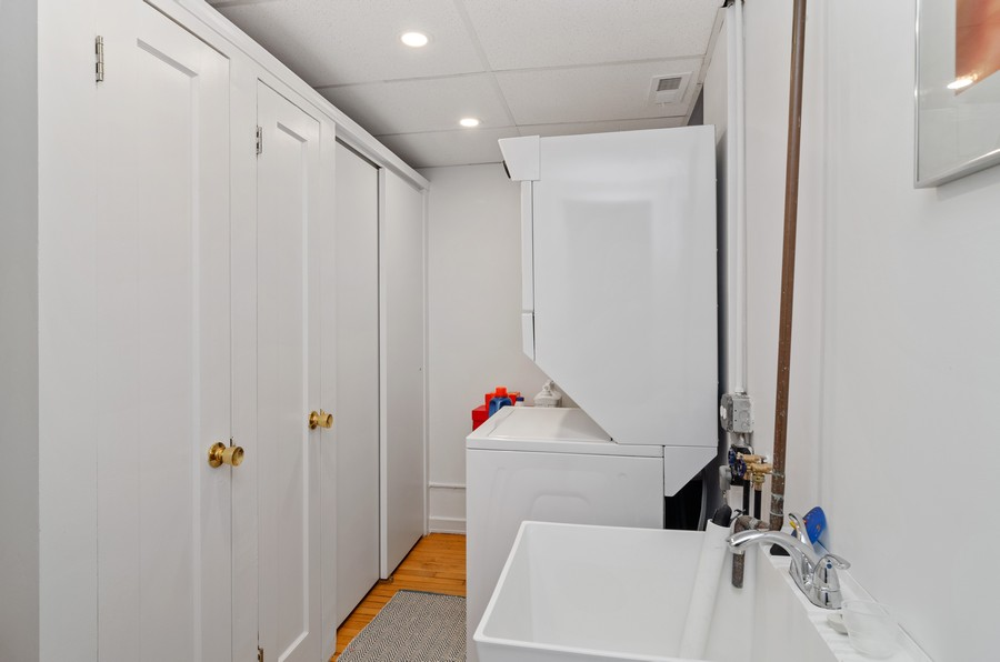 Real Estate Photography - 237 E Delaware Pl, Unit 7B, Chicago, IL, 60611 - Laundry Room