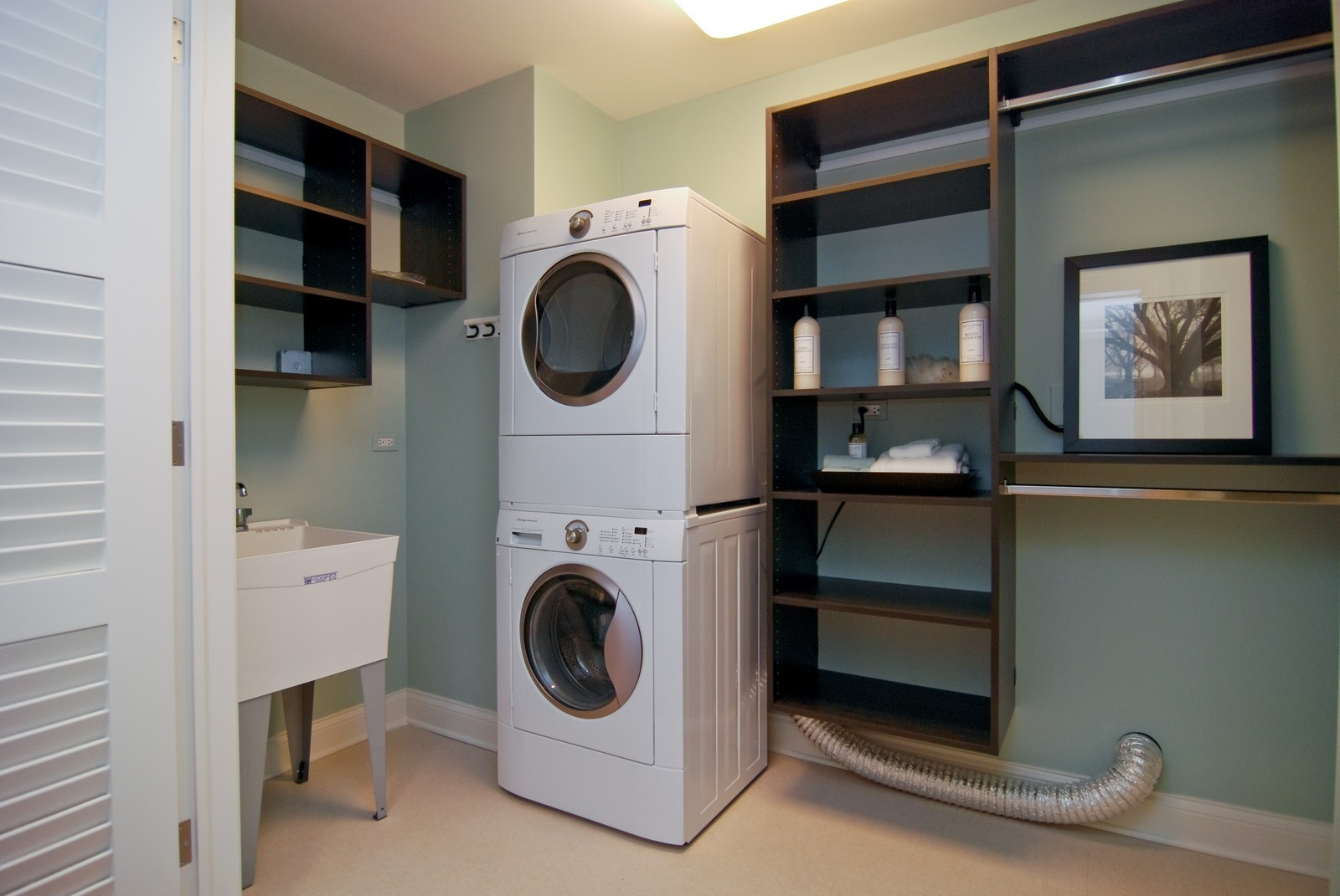 Real Estate Photography - 10 E Delaware Ave, Chicago, IL, 60610 - Laundry Room