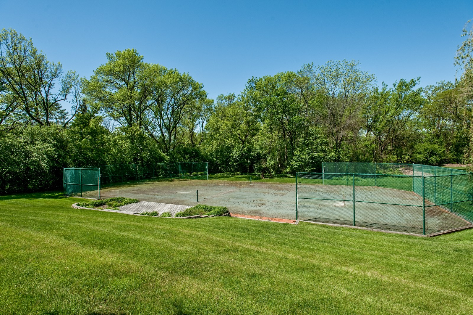 Real Estate Photography - 804 Happ Rd, Northfield, IL, 60093 - Tennis Court
