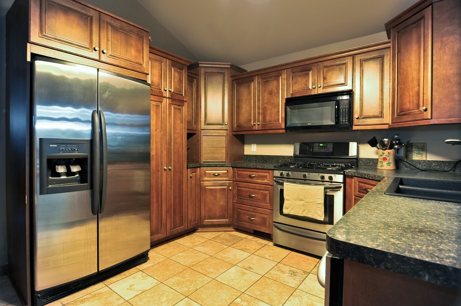 Real Estate Photography - 23250 Florian Dr, Wilmington, IL, 60481 - Kitchen opens to the Living Room (main residence)