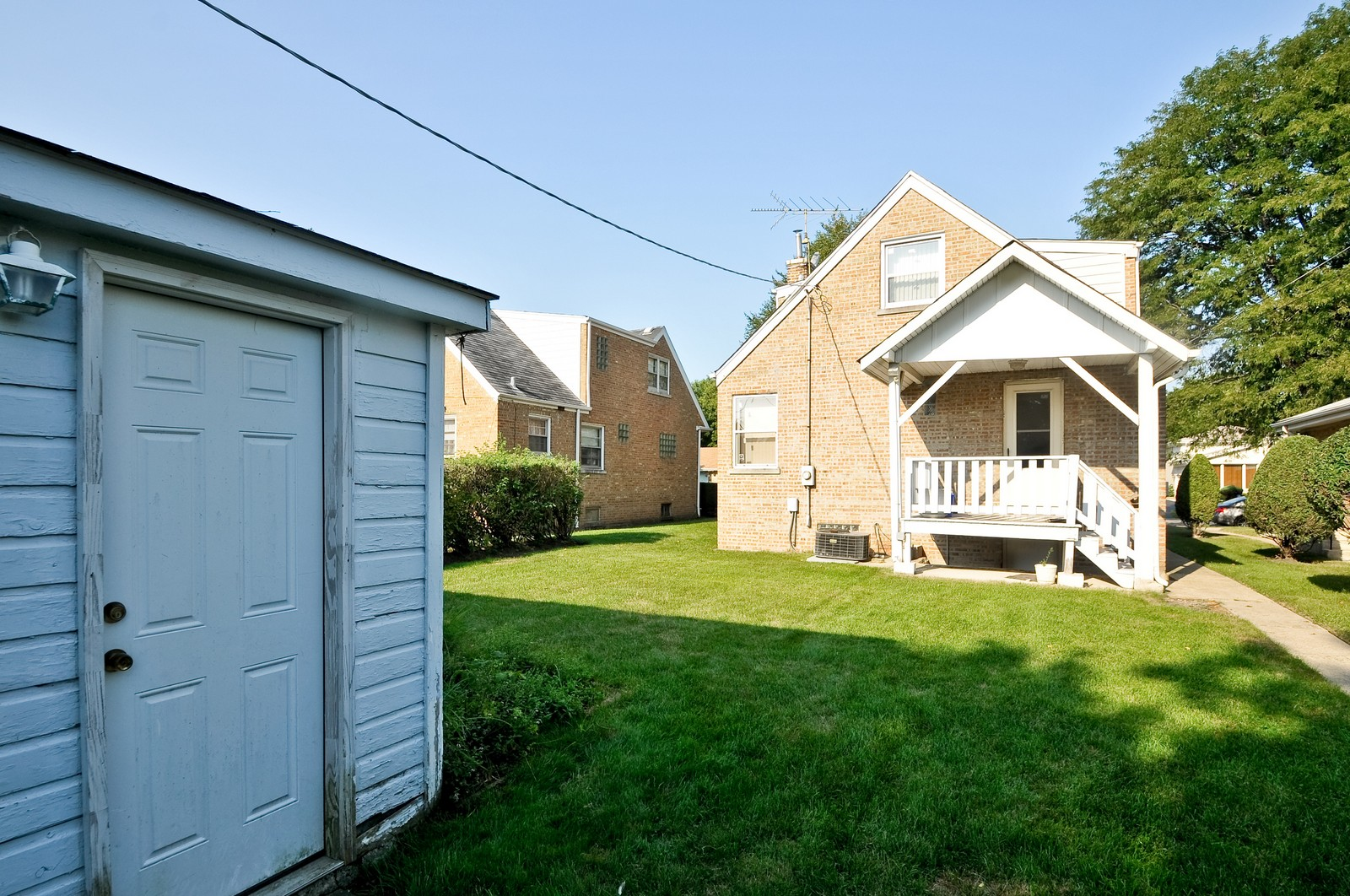 Real Estate Photography - 7227 N Lowell, Lincolnwood, IL, 60712 - Rear View