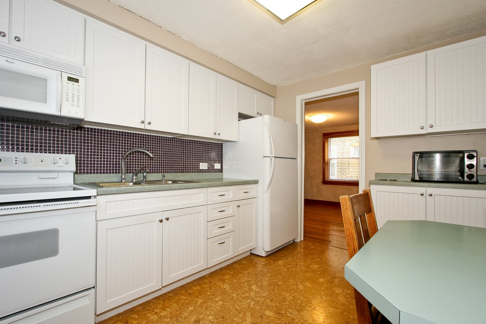Real Estate Photography - 11246 S Avenue L, Chicago, IL, 60617 - Kitchen