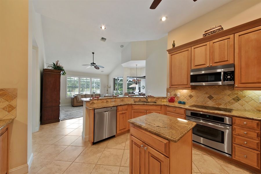 Real Estate Photography - 811 Ashburton Dr, Naples, FL, 34110 - Family Room / Kitchen