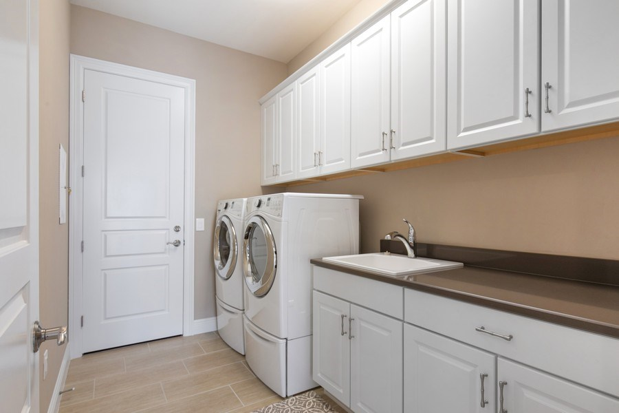 Real Estate Photography - 16433 Carrara Way #301, Naples, FL, 34110 - Laundry Room