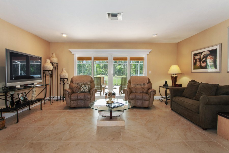 Real Estate Photography - 3480 19th Ave SW, Naples, FL, 34117 - Living Room