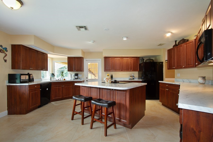 Real Estate Photography - 3480 19th Ave SW, Naples, FL, 34117 - Kitchen