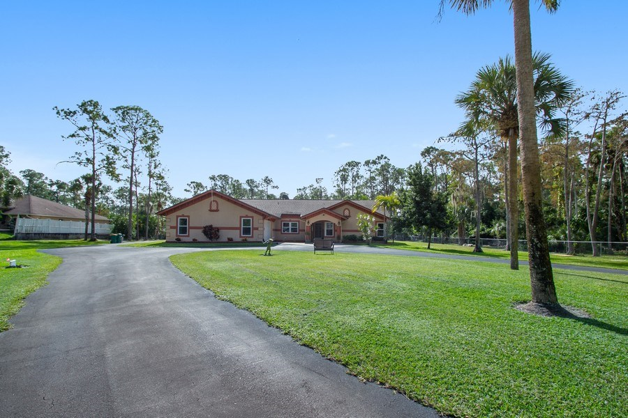 Real Estate Photography - 3480 19th Ave SW, Naples, FL, 34117 - Front Yard