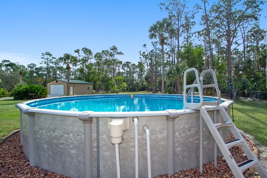 Real Estate Photography - 3480 19th Ave SW, Naples, FL, 34117 - Outdoor Pool