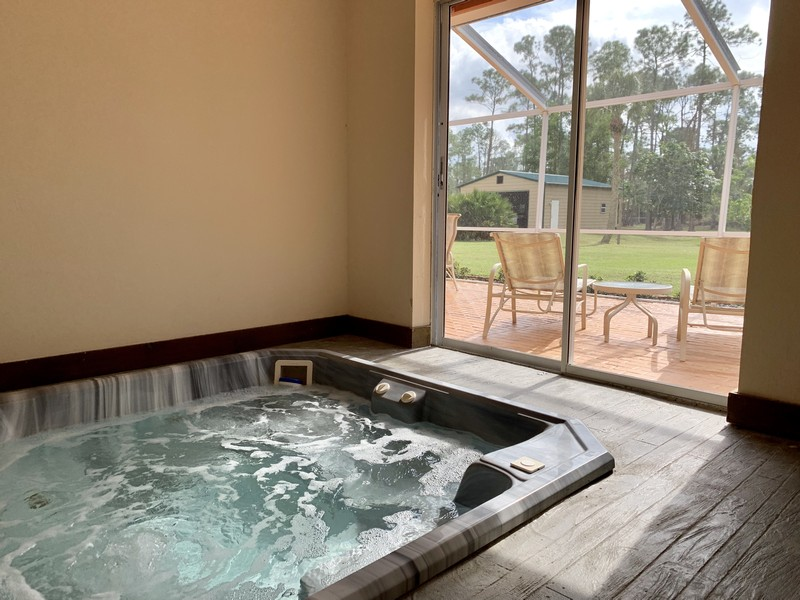 Real Estate Photography - 3480 19th Ave SW, Naples, FL, 34117 - Master bath hot tub