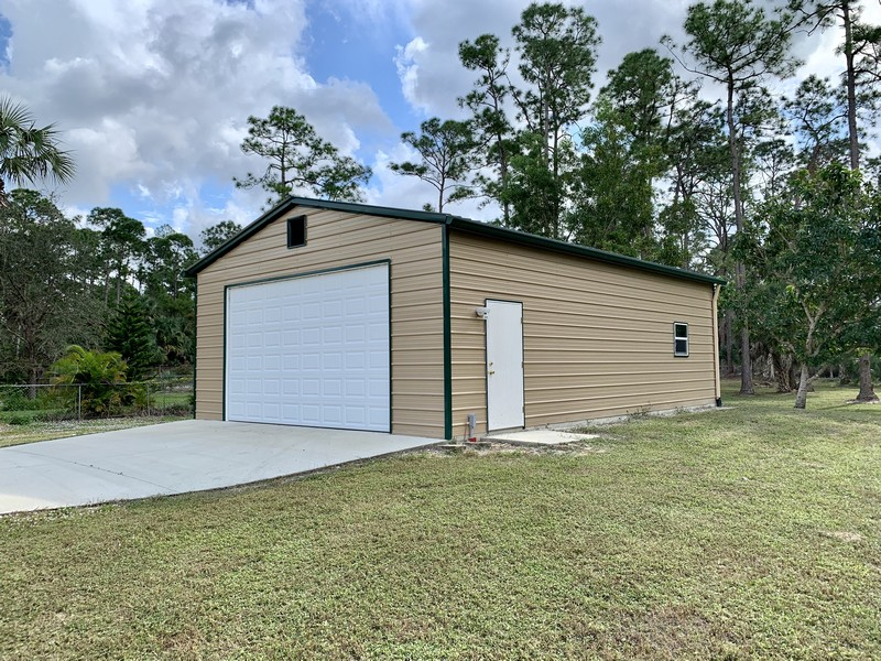 Real Estate Photography - 3480 19th Ave SW, Naples, FL, 34117 - 24'x35' garage