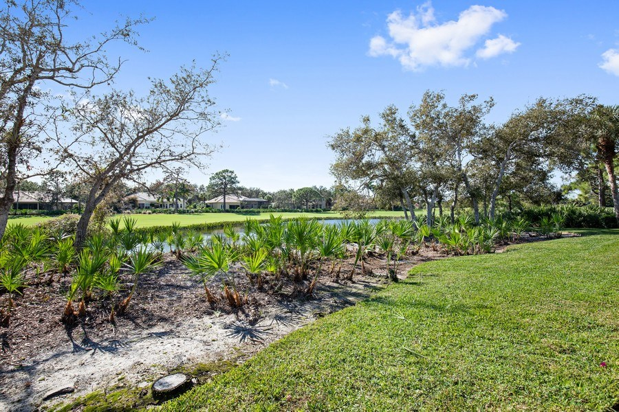 Real Estate Photography - 12266 Colliers Reserve Dr, Naples, FL, 34110 - Rear View over Lake to CR Fairway