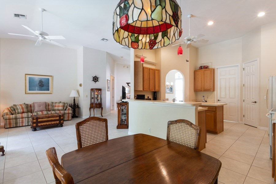 Real Estate Photography - 366 Burnt Pine Drive, Naples, FL, 34119 - Living Room / Dining Room