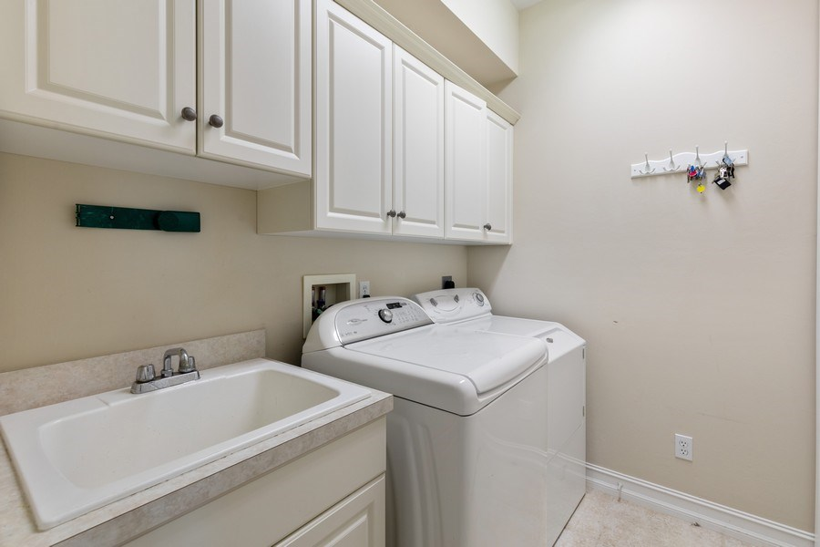 Real Estate Photography - 636 102nd Ave N, Naples, FL, 34108 - Laundry Room