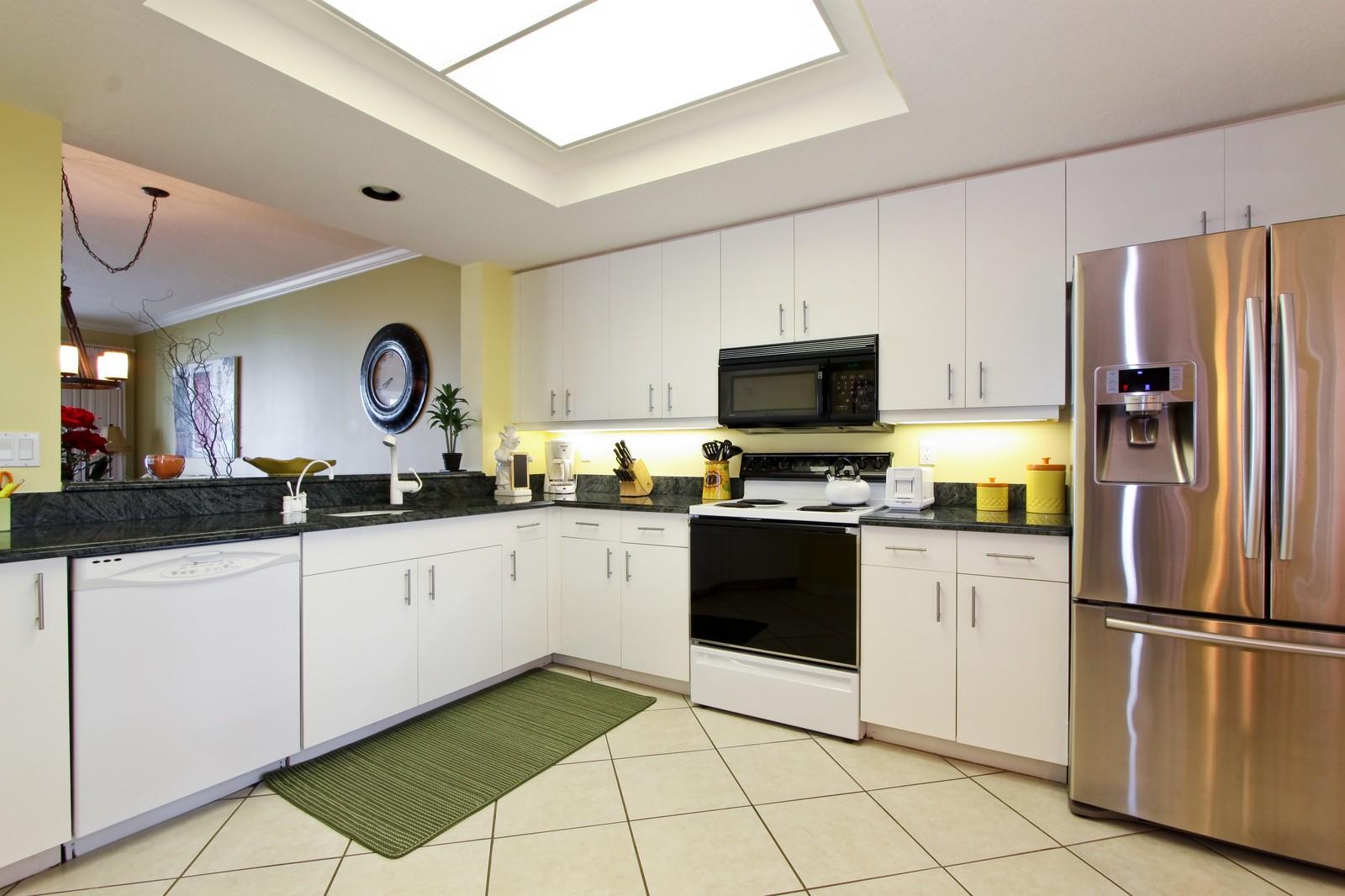 Real Estate Photography - 265 Barefoot Beach, Unit 303, Bonita Springs, FL, 34134 - Kitchen