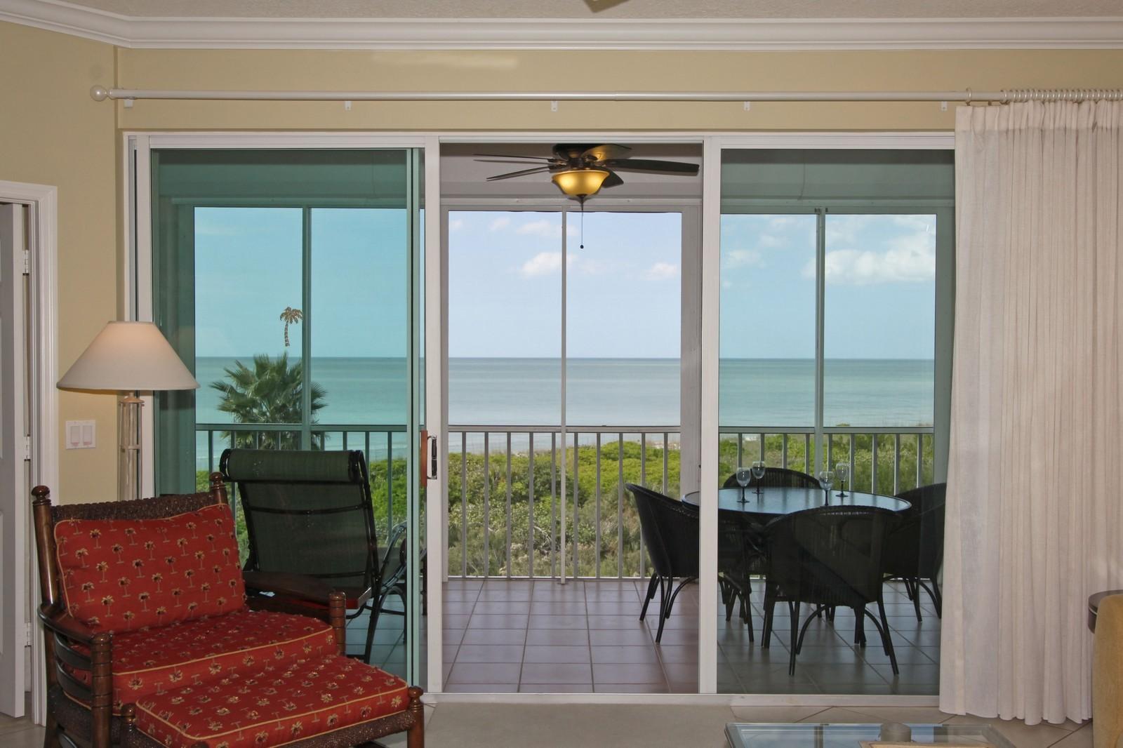 Real Estate Photography - 265 Barefoot Beach, Unit 303, Bonita Springs, FL, 34134 - Living Room / Lanai