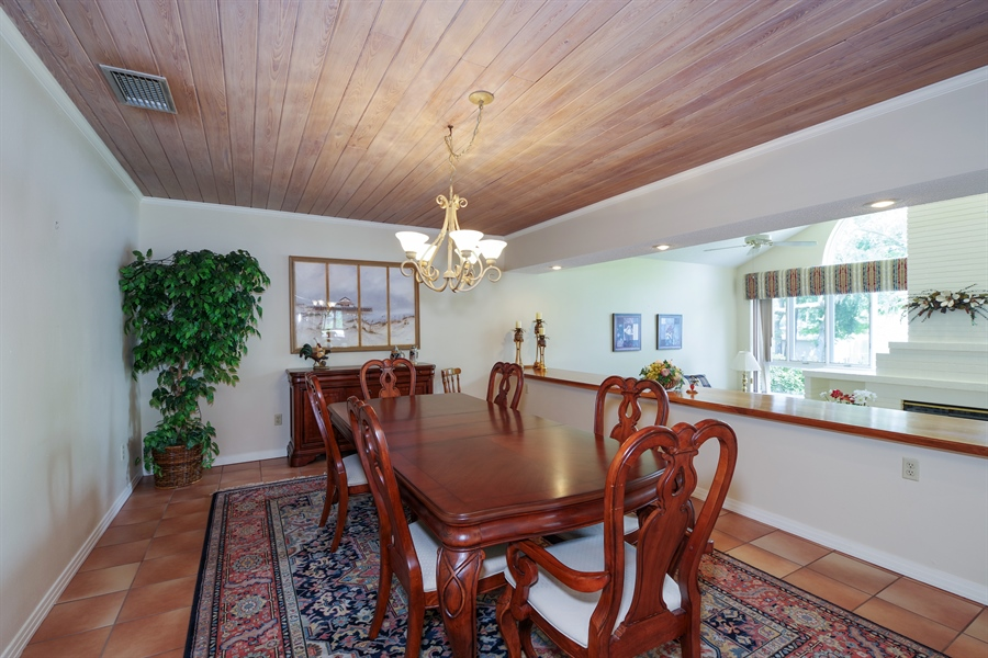 Real Estate Photography - 7001 Lake Drive, Belle Isle, FL, 32809 - Dining Room