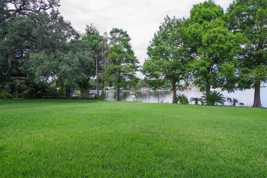 Real Estate Photography - 7001 Lake Drive, Belle Isle, FL, 32809 - Back Yard
