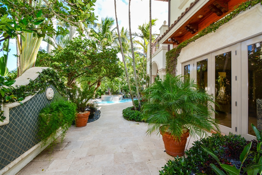Real Estate Photography - 2584 Lucille Drive, Fort Lauderdale, FL, 33316 - Side Yard View from Living Room