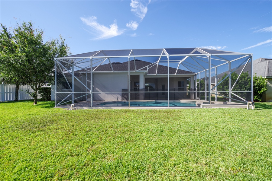 Real Estate Photography - 3620 Chardonnay Dr, Rockledge, FL, 32955 - Rear View