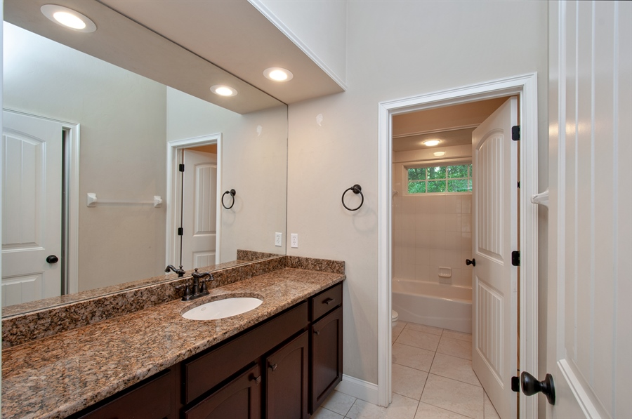Real Estate Photography - 16776 NW 2nd Road, Newberry, FL, 32669 - Jack and Jill bathroom