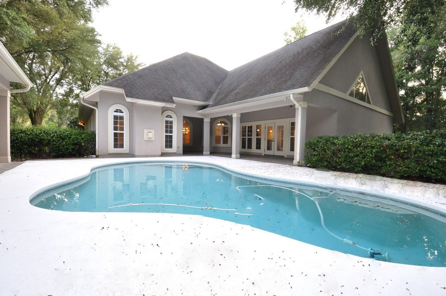 Real Estate Photography - 16776 NW 2nd Road, Newberry, FL, 32669 - House lanai, pool, and guest house