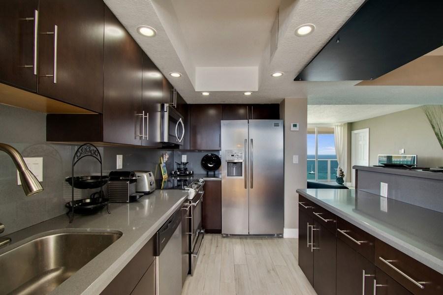 Real Estate Photography - Tiara East Condos, 333 NE 21st Ave #1802, Deerfield Beach, FL, 33441 - Kitchen