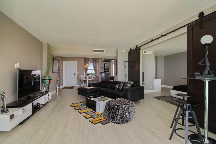 Real Estate Photography - Tiara East Condos, 333 NE 21st Ave #1802, Deerfield Beach, FL, 33441 - Kitchen / Living Room